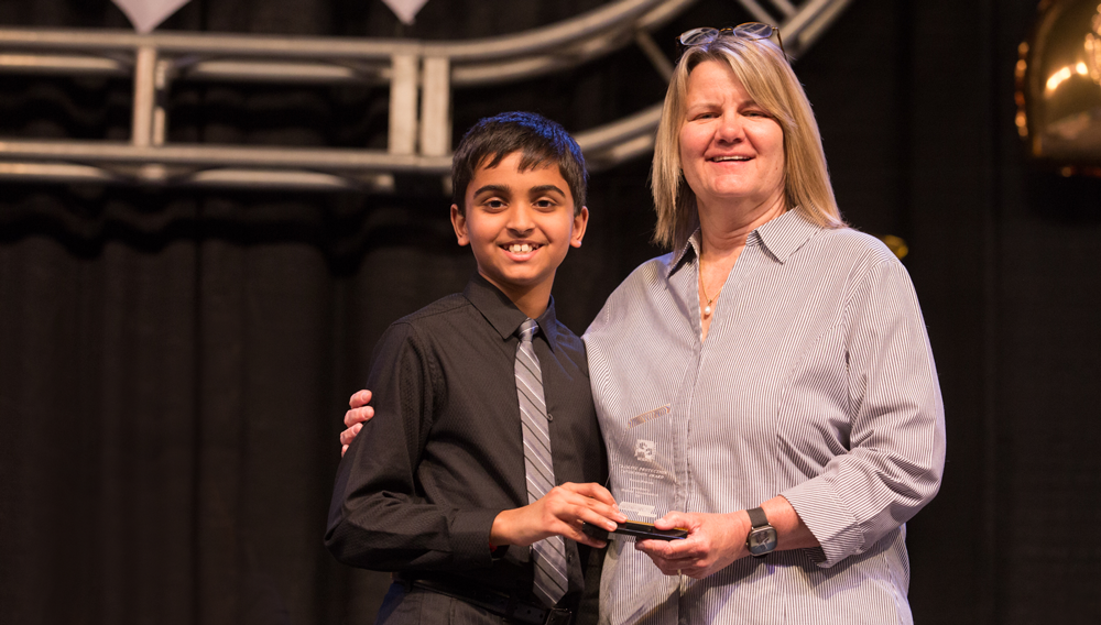 Pranav Sarma accepting an award at the Austin Energy Regional Science Fair.
