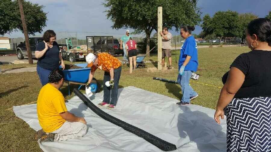 Mendez students preparing their garden beds.