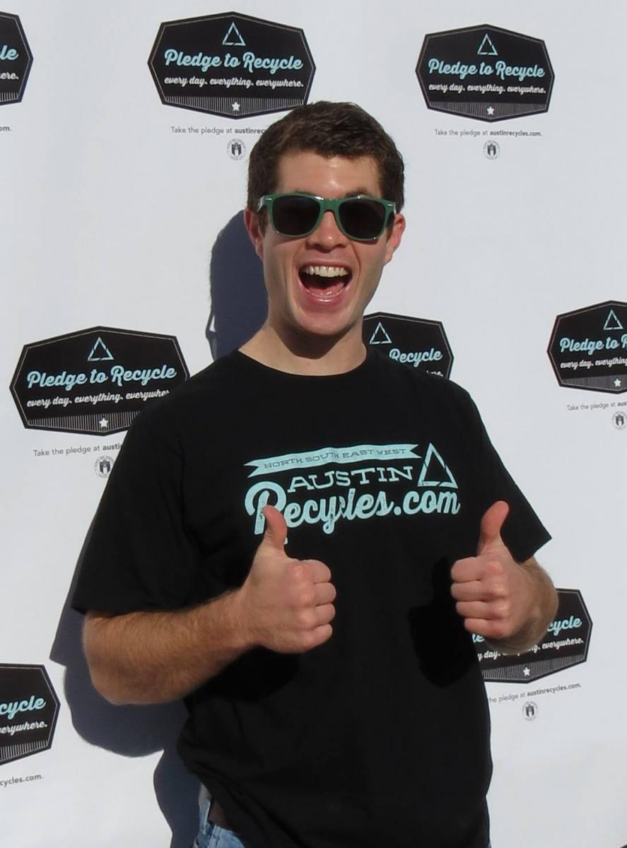 image of young man giving a thumbs up