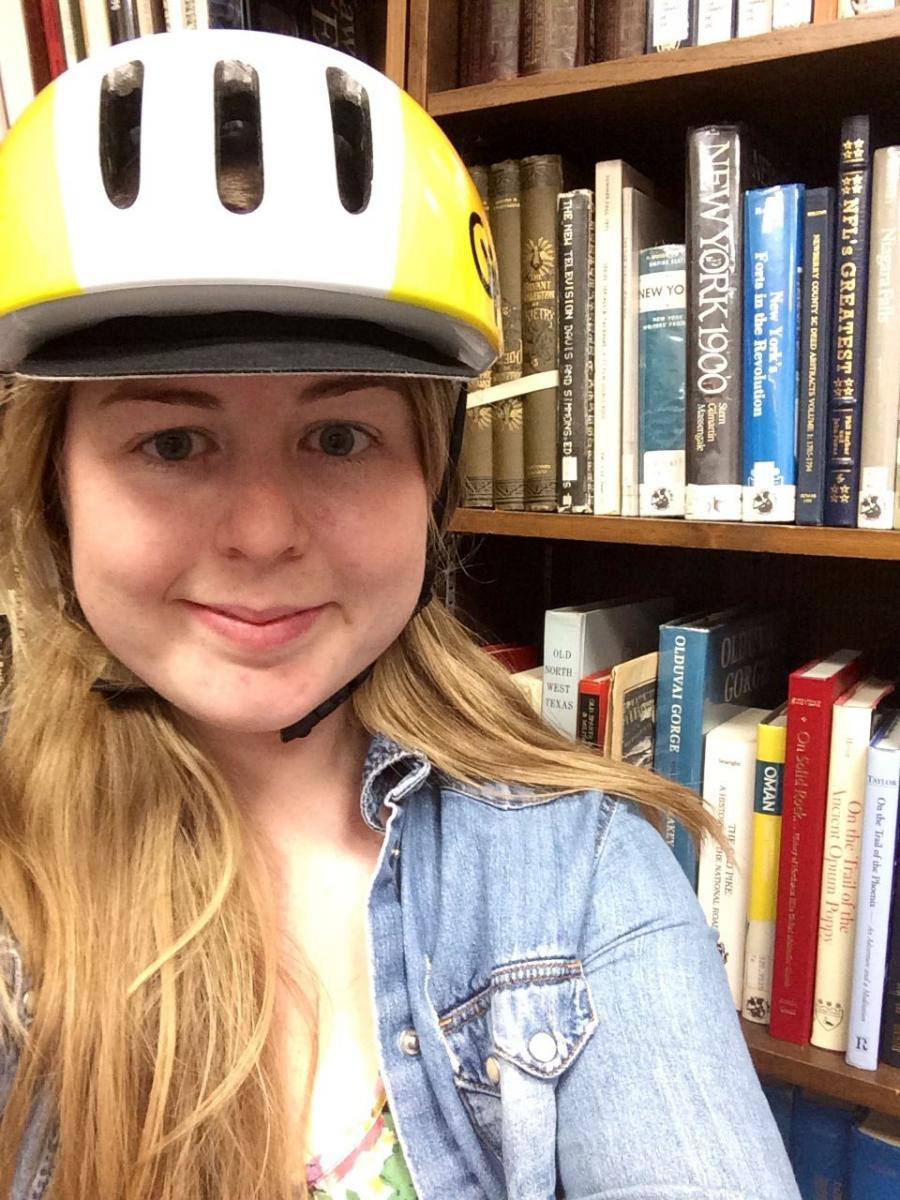 image of librarian with bike helmet
