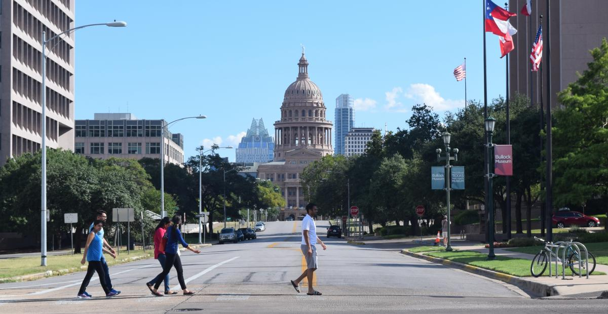 People walking in front of the Texas State Capitol building