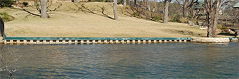 A typical bulkhead constructed to prevent shoreline erosion on Lake Austin. Bulkheads reduce shoreline habitat