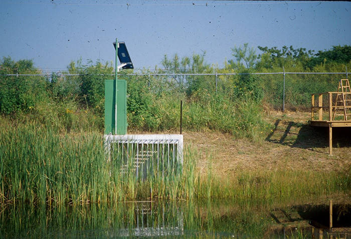 Storm water monitoring station at St. Elmo Recreational detention Pond. A flood control retention pond.