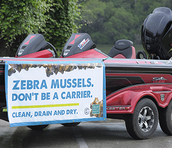 A boat advertising Zebra mussels.  Don't be a carrier!