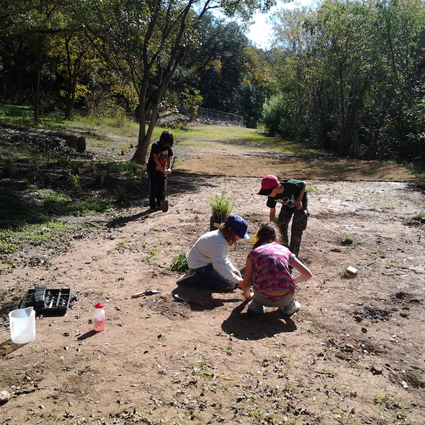 Children working in the creek.