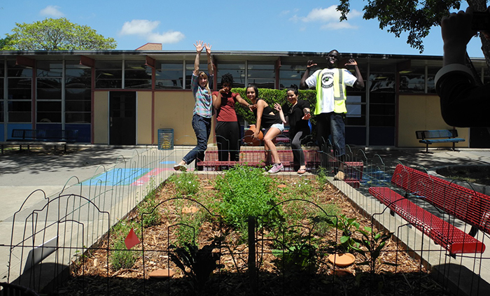 Eastside Memorial High School students show off their new garden.