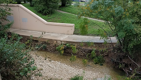 Photo showing erosion underneath the trail.
