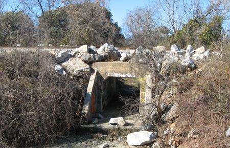 Photo of railroad crossing and culvert at the creek