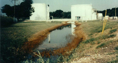 Gasoline spill from above ground storage tanks at a tank farm.