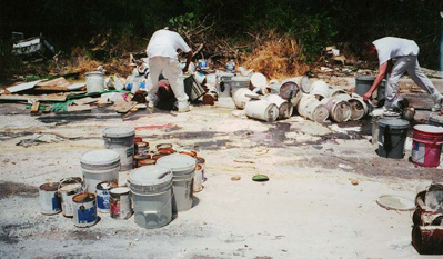 Illegal dumping of paint containers.