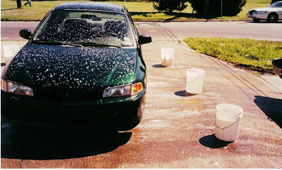 Illegal soapy discharge from a rental car facility washing operation.