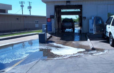 Soapy discharge from a poorly designed car wash facility.
