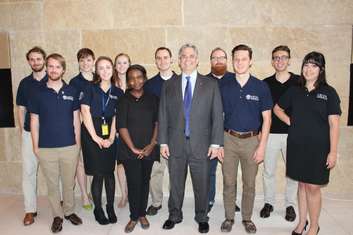 Image of Mayor Alder with AmeriCorps Vista employees