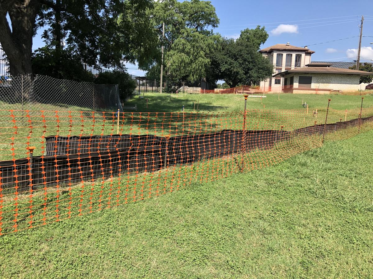 The beginning of construction starts with the construction fencing around the area.