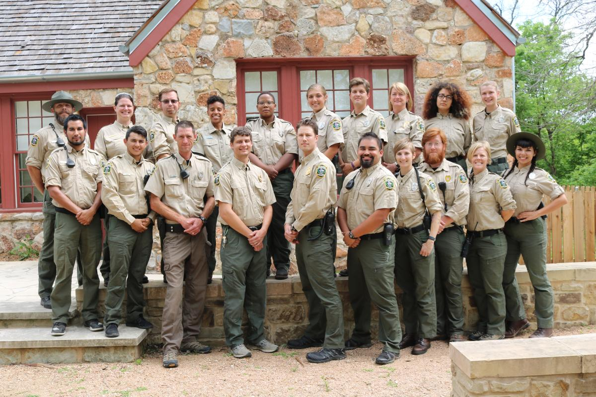 Park ranger group portrait in front of ranger cottage