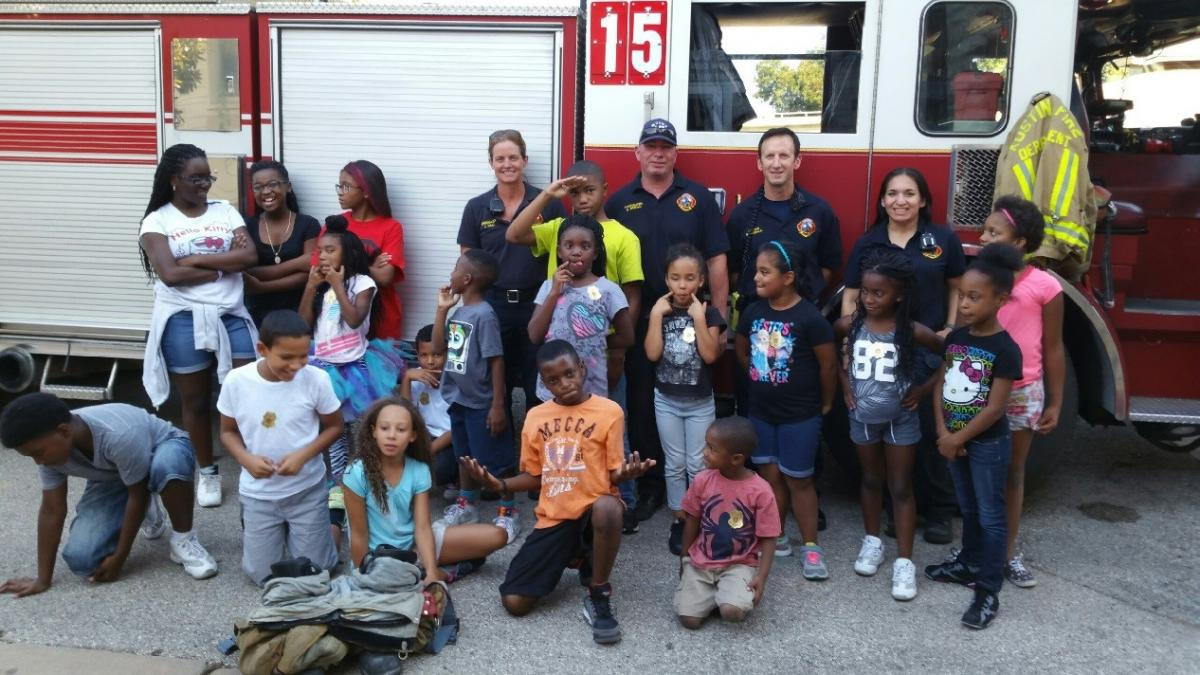 Duffie participants with firemen