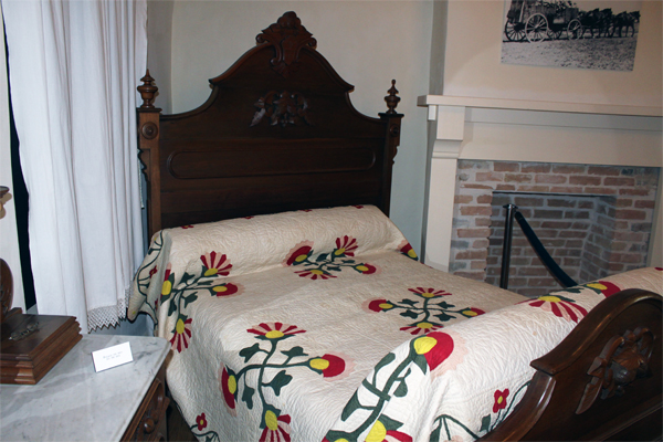 photo of bed with quilt