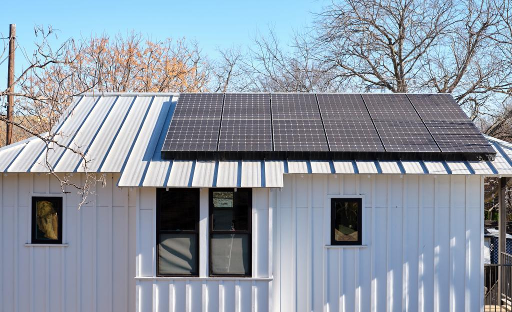Home with solar panel on roof.