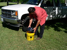 Remove the bucket lid. It is designed to be the drain pan for the oil change.